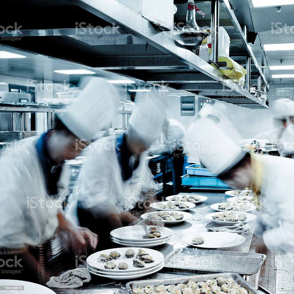Motion Chefs Of A Restaurant Kitchen Stock Photo & More Pictures of ...