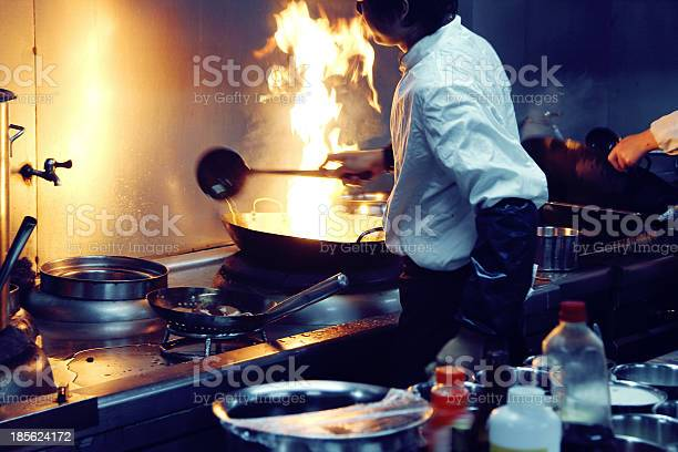 Motion Chefs Of A Restaurant Kitchen Stock Photo - Download Image Now