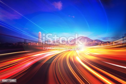 istock Motion Light Effect on City Night Background 698773992