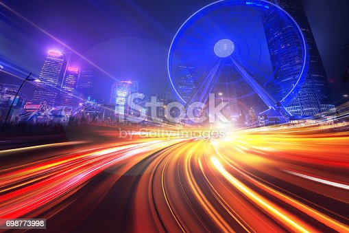 istock Motion Light Effect on City Night Background 698773998
