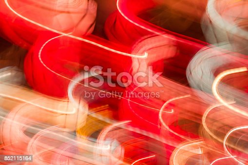 istock Motion lights at night bokeh abstract background. 852115164