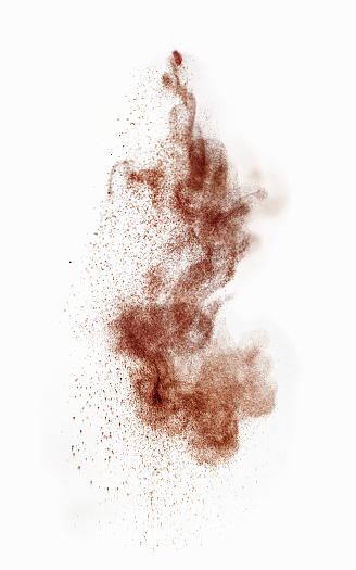 Coffee or cocoa powder falling , studio shot, selective focus.