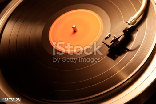 Motion of the turntable of warm toned image with shallow depth of field