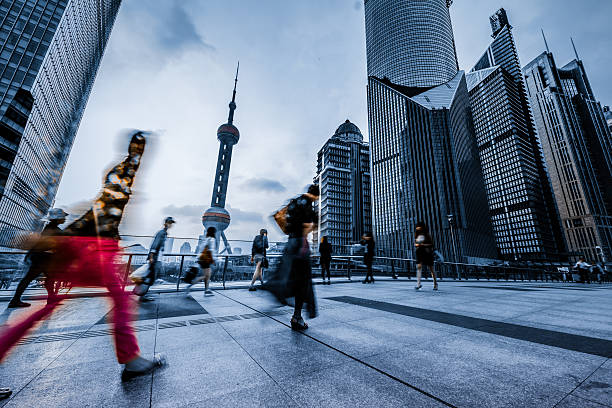motion passengers at shanghai china motion passengers walking on the landmark of shanghai china background. shanghai stock pictures, royalty-free photos & images
