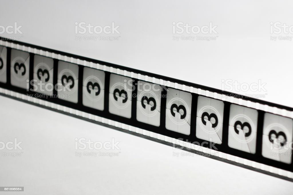 Motion picture film strip. Film countdown leader with the number three on it. stock photo