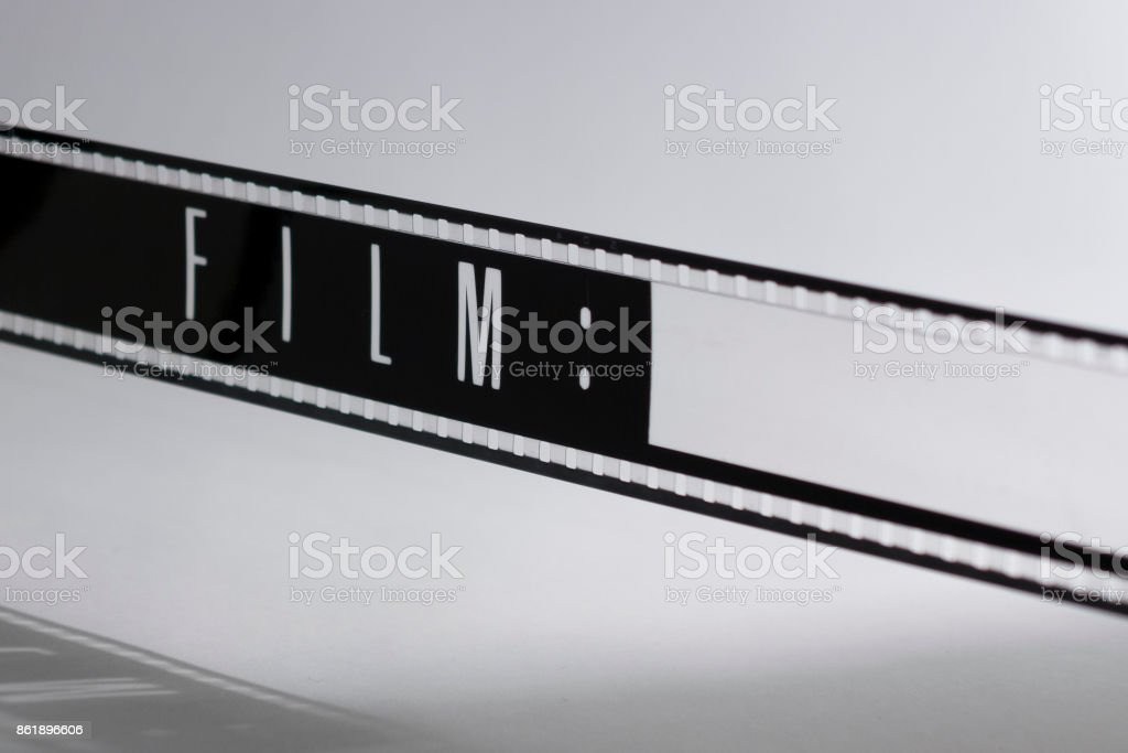 Motion picture film strip. Film countdown leader with the word film on it. stock photo