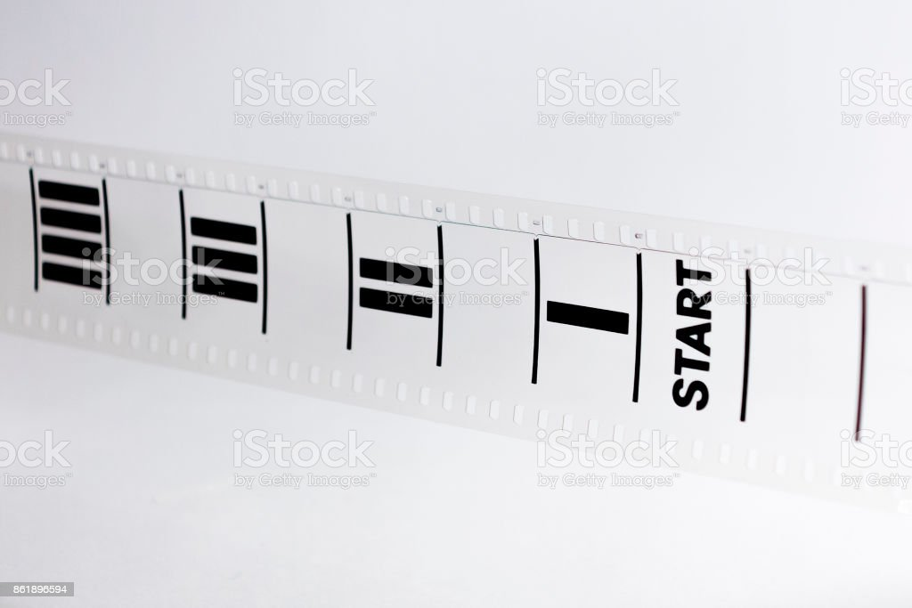 Motion picture film strip. Film countdown leader with the word start on it. stock photo