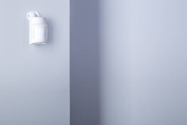 Motion sensor for security system Motion sensor for security system mounted on wall. sensor stock pictures, royalty-free photos & images