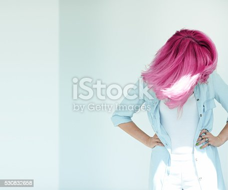 Motion shot of woman's hair. Dyed hair in daylight concept. Beautiful woman with copyspace.
