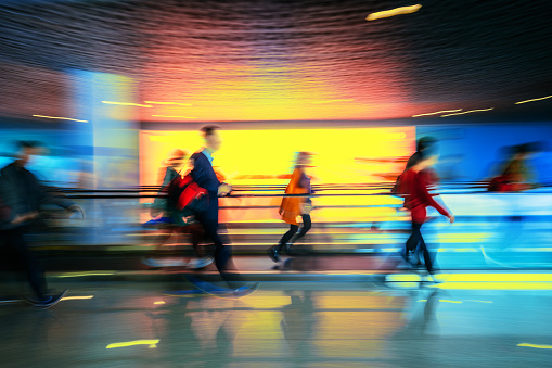 Motion-blurred abstract people walking to the airport terminal