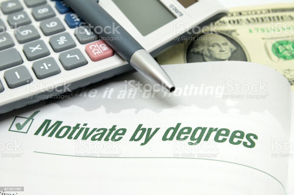 Motivate by degrees printed on book stock photo