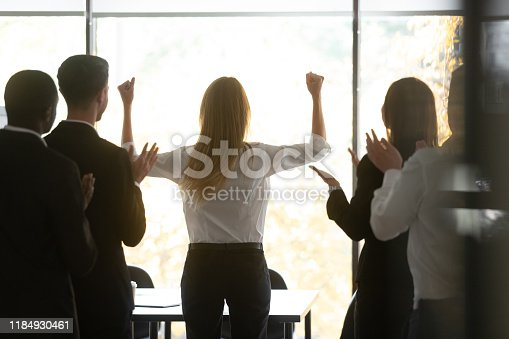509032417 istock photo Motivated female leader get team applause celebrate success victory 1184930461