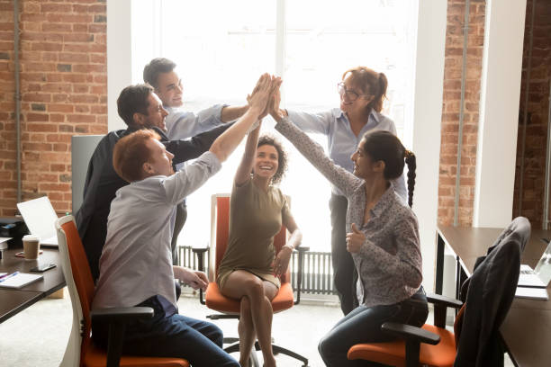 motivated happy diverse office people group giving high five - legame affettivo foto e immagini stock