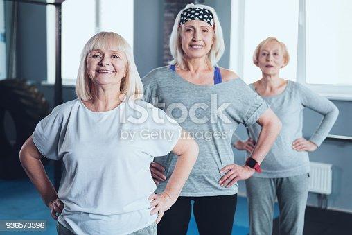936573360istockphoto Motivated senior ladies posing with smile for camera 936573396