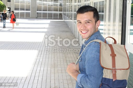 868483314 istock photo Motivated student holding books at school 918949872