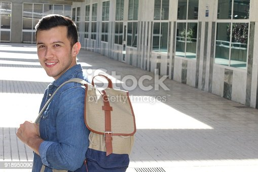 868483314 istock photo Motivated student holding books at school 918950090