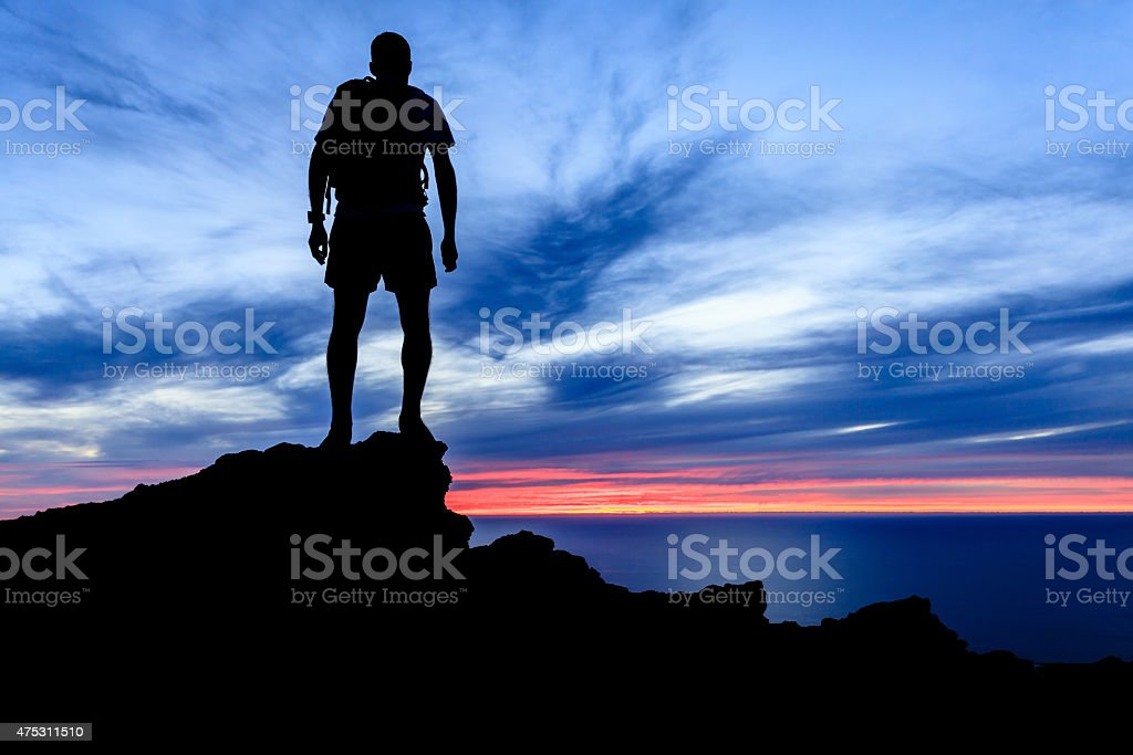 Motivation and freedom sunset silhouette stock photo