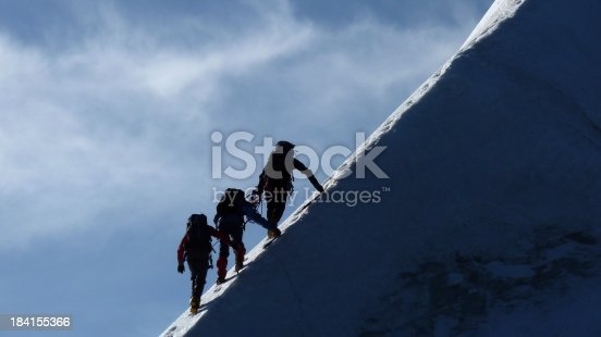 Mountaineers on a steep mountain ridge in Switzerland