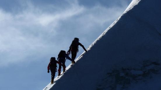 istock Motivation, Teamwork, Leadership - Mountaineers on a steep mountain ridge 184155366