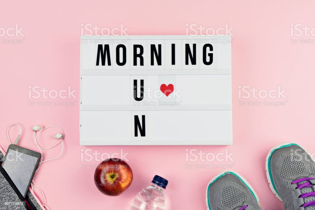 Motivation text MORNING RUN and sports accessories stock photo