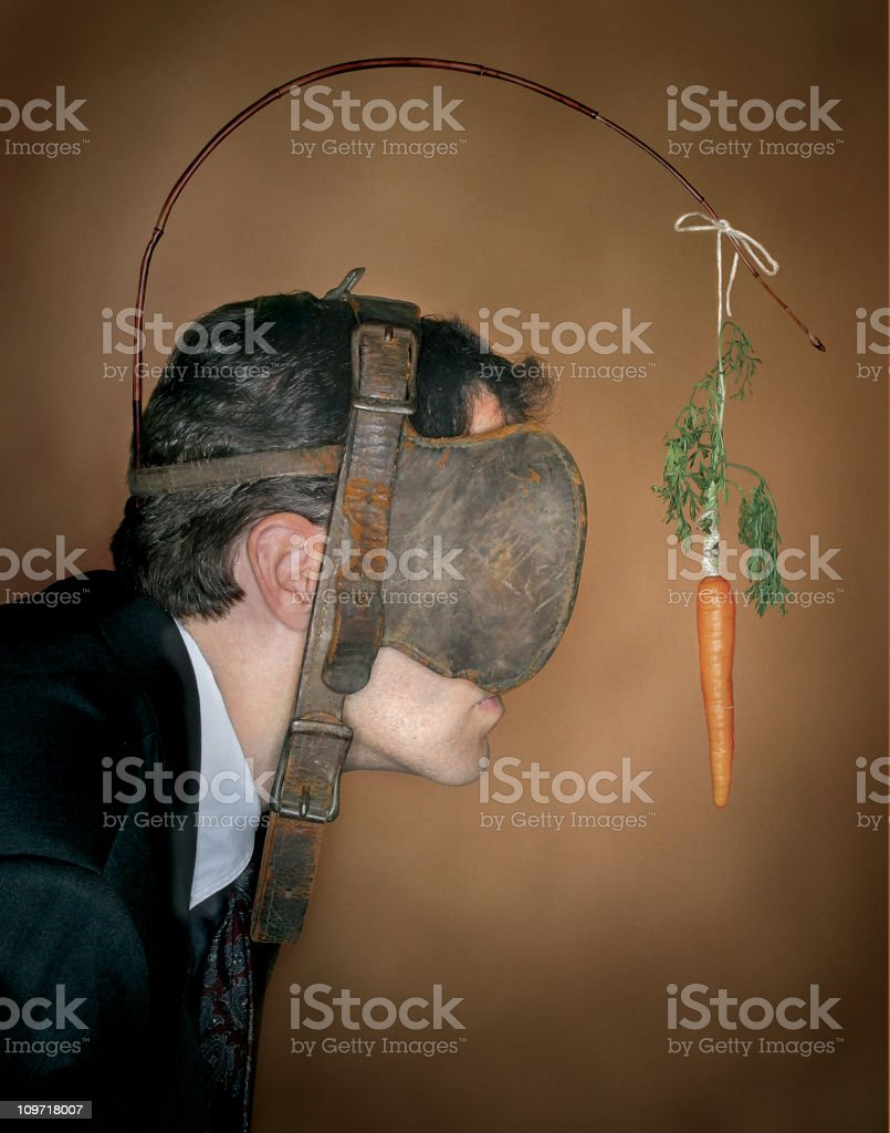 Motivation via Carrot and Stick stock photo