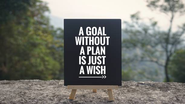 Motivational and inspirational quote. - 'A goal without a plan is just a wish' written on a blackboard. Blurred styled background. hope concept stock pictures, royalty-free photos & images