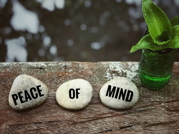 Motivational and inspirational quote. 'Peace of mind' written on white pebbles. With blurred vintage styled background. mental wellbeing stock pictures, royalty-free photos & images