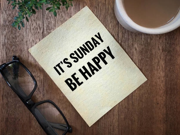 Motivational and inspirational quote. 'It's Sunday, be happy' written on a white paper. With vintage-styled background. sunday stock pictures, royalty-free photos & images