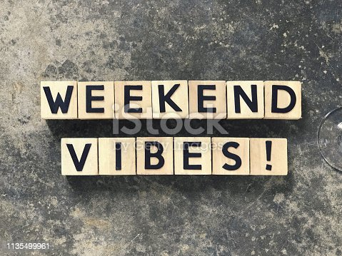 WEEKEND VIBES written on wooden blocks.