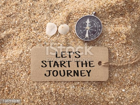 Let's Start The Journey written on a paper tag.