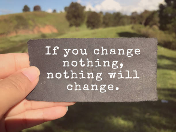 Motivational and inspirational wording. If You Change Nothing, Nothing Will Change written on a paper. Blurred vintage styled background. positive emotion stock pictures, royalty-free photos & images