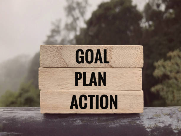 Motivational and inspirational words. Goal, Plan, Action written on wooden blocks. annual event stock pictures, royalty-free photos & images