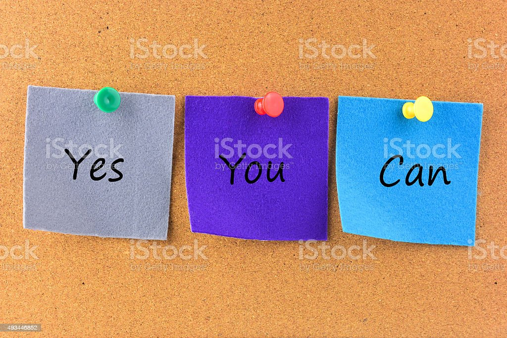Motivational Concept Image of message note paper pinned on cork stock photo