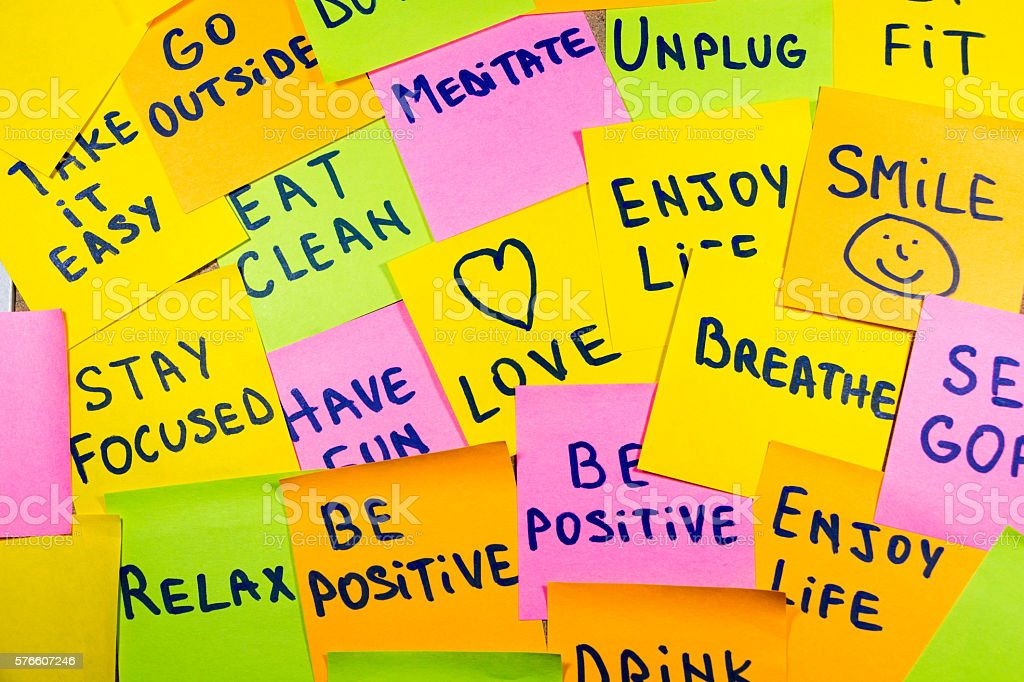 motivational lifestyle reminders on colorful sticky notes stock photo