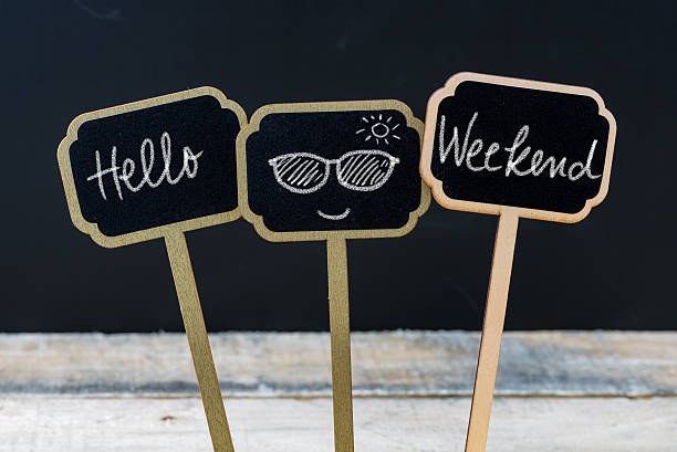 Motivational message Hello Weekend written with chalk stock photo