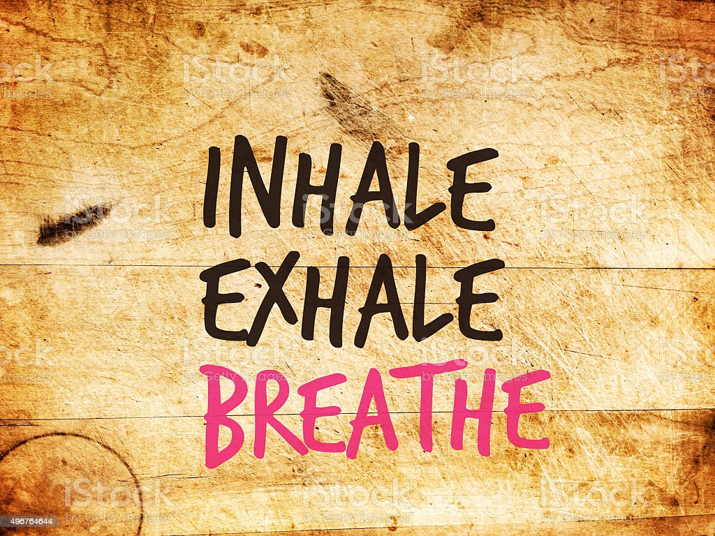 Motivational text: INHALE EXHALE BREATHE stock photo