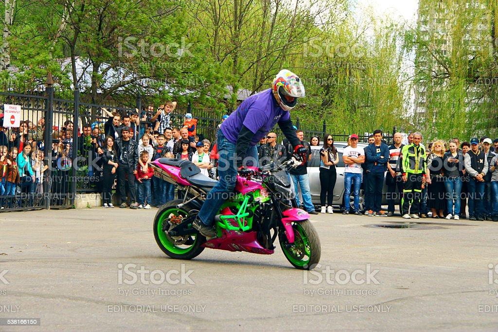 Moto free style pilot stunting on the square stock photo