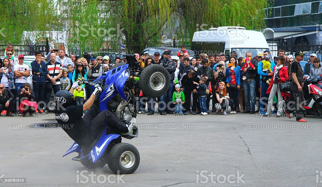 Moto free style pilot stunting on the square stock photo
