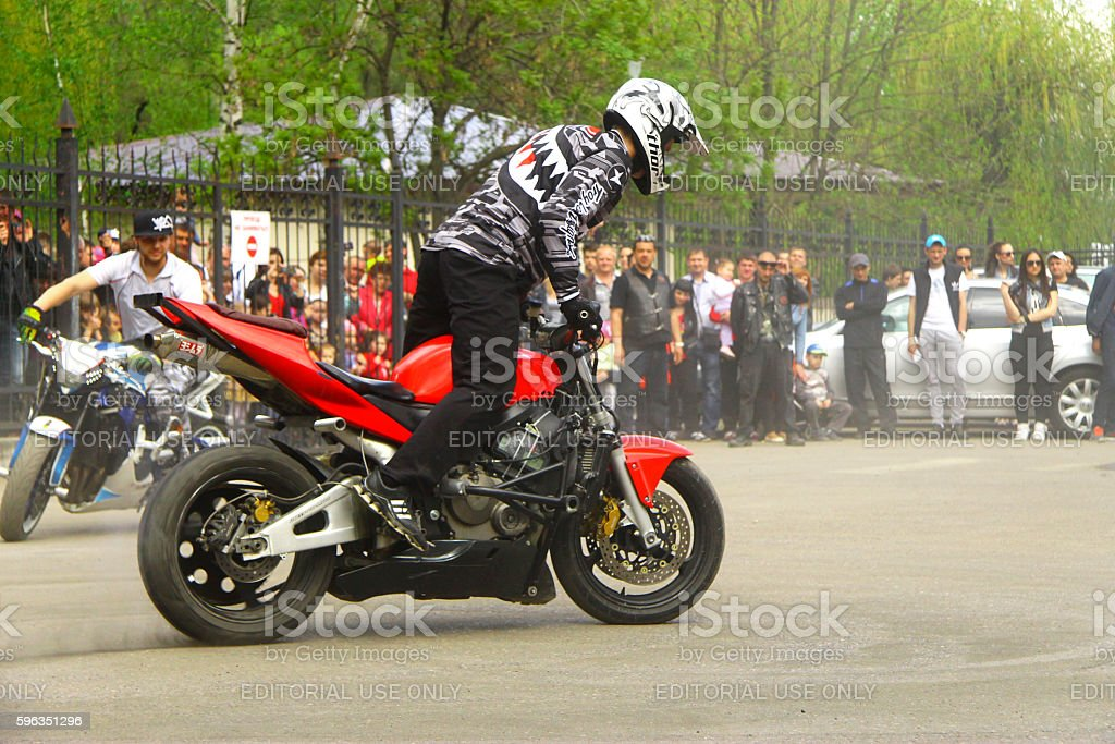 Moto free style pilot stunting on the square royalty-free stock photo