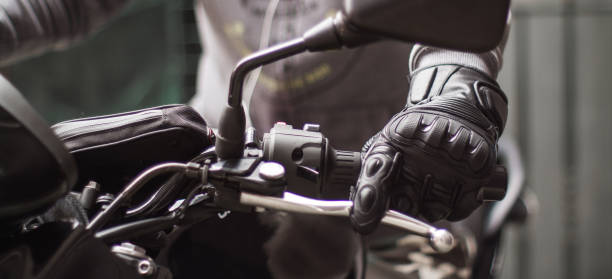 moto gloves and motorcycle close up - sports glove stock photos and pictures