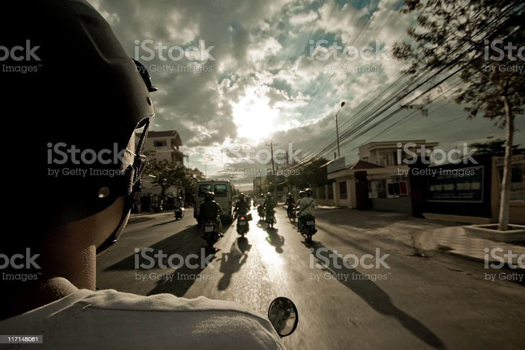 motobike view from the back on  road and sky stock photo