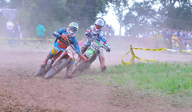 Motocross in Sariego, Asturias, Spain. Sariego, Spain - August 18, 2014: Sariego motocross in August 18, 2014 in Sariego, Spain. Motorcycle Rider Ivan Cervantes and Cedric Soubeyras in the motorbike race. kawasaki heavy industries stock pictures, royalty-free photos & images