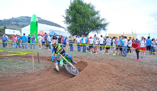 Motocross in Sariego, Spain. Sariego, Spain - August 17, 2015: Legendary Sariego motocross test in August 17, 2015 in Sariego, Spain. Francisco Utrilla rider with the number 76. kawasaki heavy industries stock pictures, royalty-free photos & images