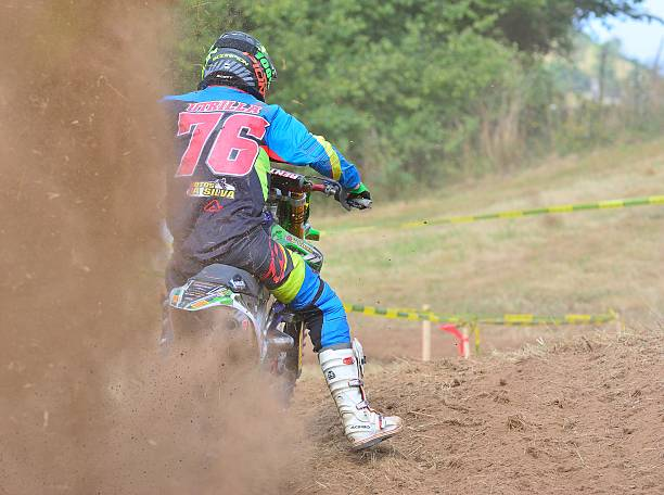 Motocross in Sariego, Spain. Sariego, Spain - August 17, 2015: Legendary Sariego motocross test in August 17, 2015 in Sariego, Spain. Francisco Utrilla rider with the number 76 kawasaki heavy industries stock pictures, royalty-free photos & images