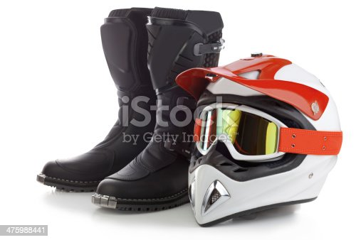 Motocross boots and protective helmet for motorcycle riding isolated on white