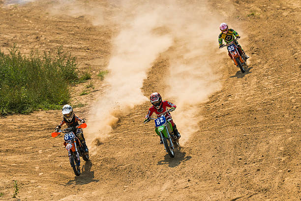 Motocross racers  overcome a track  on the Ukrainian championshi Lviv, Ukraine - September 11, 2016: The third stage of the Ukrainian championship in cross-country cycling . Unknown  racers  overcome a track . three wheel motorcycle stock pictures, royalty-free photos & images