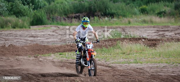 istock A motocross rider in action, practising on a sand course 1309063521