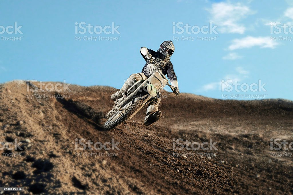 Motocross rider on race track stock photo