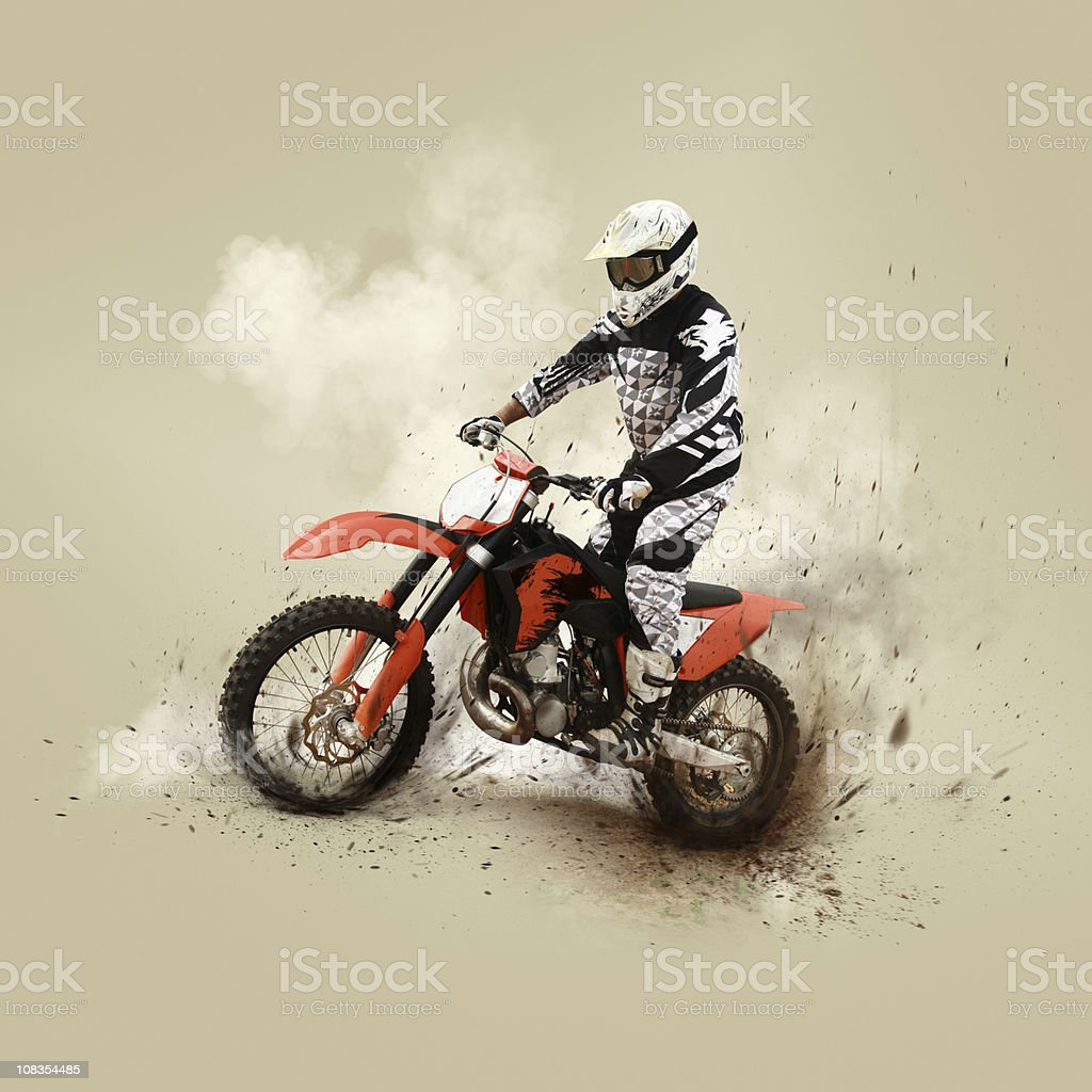 Motocrossing competitor on his motorcycle royalty-free stock photo