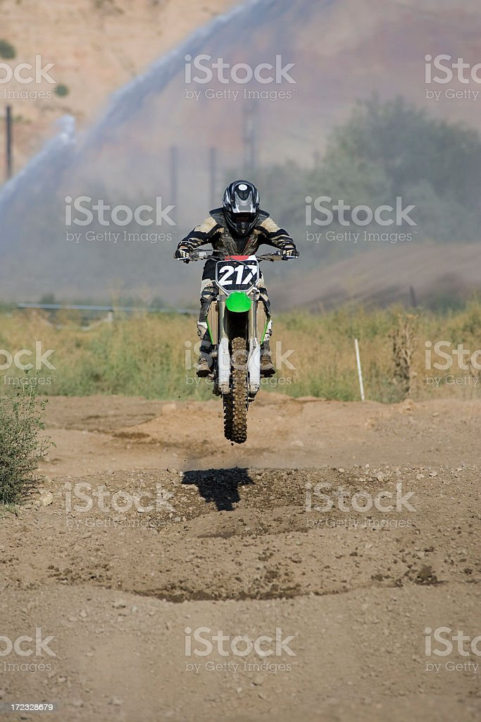Motocross-rider flying over whoops section stock photo